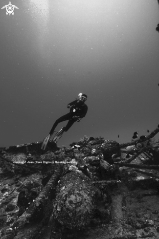 A Diver on the Silver Star shipwreck 35m Coin de Mire,Mauritius